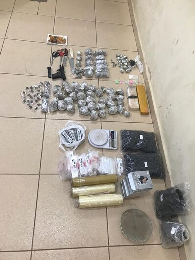Casal é detido com arma e entorpecentes no Santa Felícia - Crédito: Divulgação